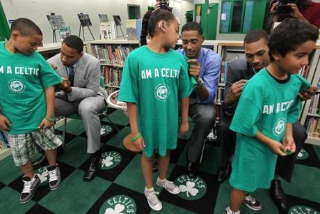 Allston, Ma., 07/02/12, The Boston Celtics introduced their new draft picks at the Jackson Mann/Horace Mann Complex in Allston, MA, just before they unveil a renovated library and multipurpose room that was donated by the Boston Celtics Shamrock Foundation. Left to right, new Celtics Jared Sullinger, Fab Melo, Kris Joseph, cq, signed shirts of Devonte Baptista, 11, Chloe Jean-Pierre, 10, and Christian Turbides, 8, all cq. Suzanne Kreiter/Globe staff