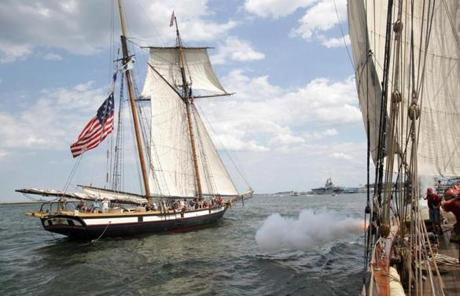 Tall ships Lynx and Pride of Baltimore II fired cannon shots at each other Sunday afternoon in Boston Harbor.
