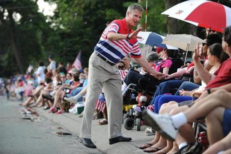 Wakefield, MA 070412 Sen. Scott Brown greeted spectators during the Wakefield Fourth of July Parade. (Essdras M Suarez/ Globe Staff)/ MEt