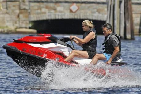 Mitt and Ann rode a jet ski around Lake Winnipesaukee.