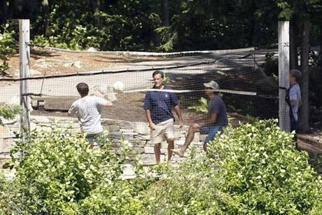 Mitt Romney, center, played volleyball with his sons.
