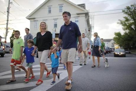 Mitt Romney and his wife, Ann, walked with their grandchildren across Main Street in Wolfeboro, N.H. The Romneys are vacationing at their home in the town for the week of Fourth of July.