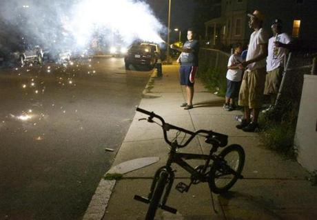 Revelers lit off fireworks in front of a Bowdoin-Genava home during a July 4 party.