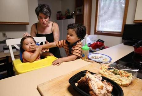 Kathy Colthart  of Watertown (with her children Logan and Lucas Pelegrin) said prepared foods