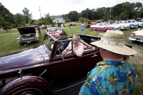 FOR METRO. Dedham, MA 7/8/2012 Carl Chiaretto (cq) of Medford, in the driver's seat, speaks with Jon Conlon (cq) of Taunton as Chiaretto waits in line to be awarded 3rd place in the D class of the auto show. The car, a 1937 Packard Super 8 Roadster, belongs to Henry Vara III of Newton. In the passenger seat is Tony Dagata (cq) of Woburn. Chiaretto and Conlon have been coming to the auto show for about 30 years.