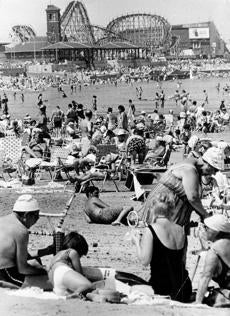 July 8, 1968: The Cyclone, one of the largest roller coasters in the United States, can be seen in the background as people sunbathed at Revere Beach. Built in 1925 by Harry Travers for $125,000, its cars traveled at a speed of 50 miles per hour and its climb reached a 100 feet. Leo Hurley, whose father and uncle started the amusement era on Revere Beach in 1898 and who ran the last rides before the amusement park closed in 1978, said Revere Beach was