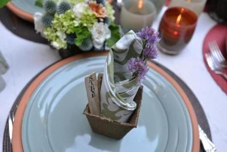 Table settings included planters and terracotta bases.