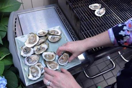 Faison grilled oysters for guests to snack on.