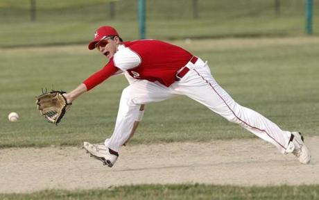 Newburyport's Bret Fontaine stretches for a ground ball during an American Legion baseball game against North Andover Tuesday, July 10, 2012. (WINSLOW TOWNSON FOR THE BOSTON GLOBE)