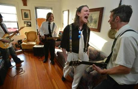 From left: Rob Manochio, Tom Appleman, Rick Berlin, and Ricky McLean rehearse in Berlin's apartment.