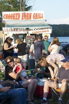 """Friday Night Live"" is a weekly music and barbecue event on the Island Pond waterfront."
