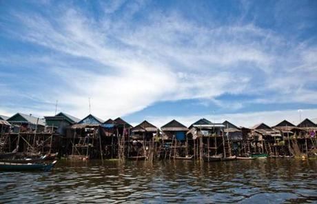 Many houses in Cambodia's ever-changing seasonal lakes are built on stilts. They rise above a muddy plain in the dry season, but are surrounded by a sea of water when the rains come.