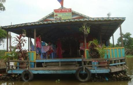 A floating cafe in the village of Kampong Phluk. Instead of erecting stilts, some residents elect to ebb and flow with the waters.