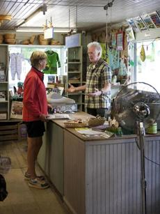 Jack Garvin, manager at the Warren Store in Warren, Vt., chatting with a customer.