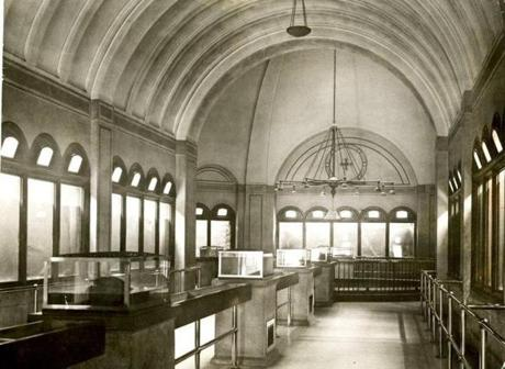 January 11, 1921: Interior of the Marine Park Aquarium, the third aquarium in Boston's history which operated from 1912-1954. It opened to the public on Thanksgiving Day November 28, 1912. Standing on Marine Park, directly opposite the end of East 3rd St, the aquarium was built and maintained from the income of the Parkman fund, which was devoted to park purposes of Boston. The exhibition tanks, shown here, were about six feet wide and four feet high. The salt water fish lived on one side and the fresh water on the other.