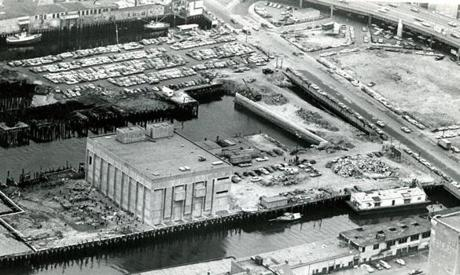 April 8, 1968: The New England Aquarium on Central Wharf, which was slated to open May 25, 1968, is shown the week after a five-alarm fire gutted the wooden structure owned by the aquarium on nearby Long Wharf. Only rubble remained and the fire destroyed membership records and designs and materials for the first set of exhibits which included valuable underseas photographs. The fire was just the first in a series of setbacks. Problems with the piping system required all the pipes to the Giant Ocean Tank, the museum's centerpiece, to be replaced, and the aquarium did not officially open until its grand celebration on June 20, 1969.