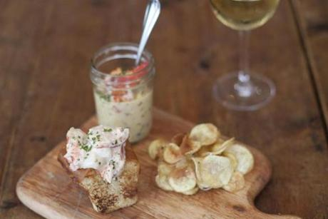 A perfect, tiny lobster roll is served with a jar of intensely rich lobster-corn chowder and potato chips dusted with Old Bay.
