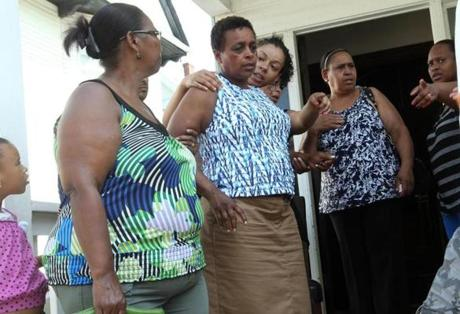 """I just want it all to go away,"" said Maria Teixiera (center), the mother of Safiro Furtado."