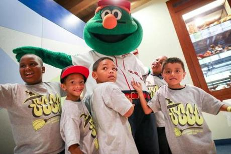 WALLY WORLD: Children from Salem Community Child Care Center meet Wally the Green Monster during a celebration of Fenway's 100th, Boston Children's Museum on July 20