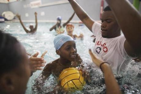 Lifeguards and swimming instructors played a game of water polo at the Boys & Girls Club in Roxbury, where children are required to take swim lessons.