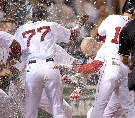 Boston Red Sox right fielder Cody Ross was showered with Gatorade as he reached home plate after hitting a game winning 3-run home run in the bottom of the ninth inning as the Boston Red Sox took on the Chicago White Sox at Fenway Park. July 19, 2012.
