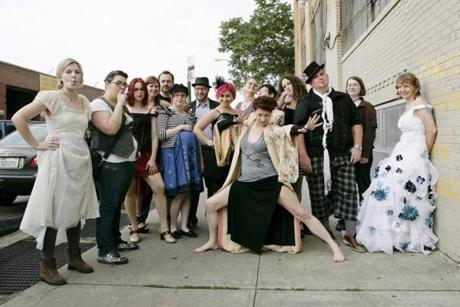 "Singer Amanda Palmer (center) with a group of fans before a performance in Brooklyn, N.Y., in June. ""I really like having that kind of relationship with my fans. I want that love from them,"" says Palmer."