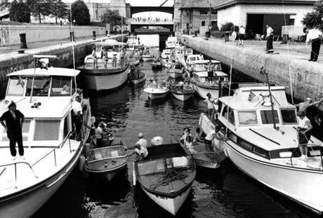 Summer traffic was bumper-to-bumper as 32 boats moved through the locks at the Charles River Basin on July 17, 1966. In the control tower, Salvatore Albondi of Nahant operated the locks, which handle 300-400 boats on a busy weekend and 3500 in a month like July.