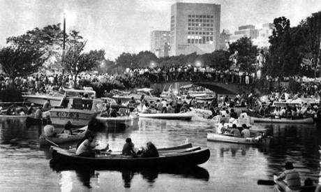 Concert-goers in motor boats, rowboats, and canoes listened as John Williams debuted his first evening as conductor of the Boston Pops on July 4, 1980. Williams played the Darth Vader theme