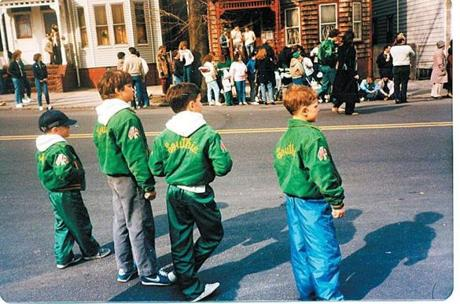 The author, second from right, watches a mid-'80s St. Patrick's Day parade in his Southie jacket.