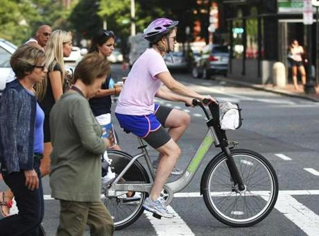 Jennifer Carp of the Back Bay rode a Hubway bicycle down Boylston Street. She picked up the bicycle at Copley Square.
