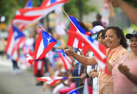 "Carmen Rivera,of Jamaica Plain, enjoyed the festivities as she does every year when she watches the Puerto Rican Festival parade. ""It's my people,"" said Rivera. ""I've got to support them."""