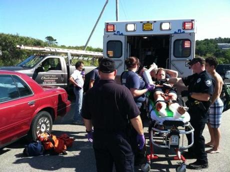 The victim was loaded on to an ambulance at Ballston Beach in Truro Monday after what officials say was a shark attack.