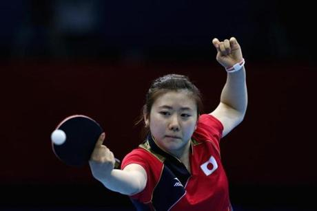 LONDON, ENGLAND - JULY 31: Ai Fukuhara of Japan completes during the Women's Singles Table Tennis quarter-final match against Ning Ding of China on Day 4 of the London 2012 Olympic Games at ExCeL on July 31, 2012 in London, England. (Photo by Feng Li/Getty Images)