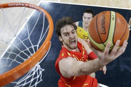 LONDON, ENGLAND - JULY 31: Pau Gasol of Spain lays up a shot as he breaks past Aron Baynes of Australia during the Men's Basketball Preliminary Round match between Australia and Spain on Day 4 of the London 2012 Olympic Games at Basketball Arena on July 31, 2012 in London, England. (Photo by Charles Krupa - IOPP Pool /Getty Images)