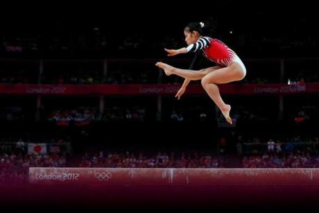 LONDON, ENGLAND - JULY 31: Yu Minobe of Japan competes on the balance beam in the Artistic Gymnastics Women's Team final on Day 4 of the London 2012 Olympic Games at North Greenwich Arena on July 31, 2012 in London, England. (Photo by Cameron Spencer/Getty Images)