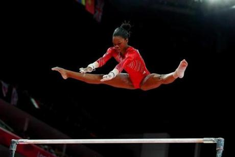 LONDON, ENGLAND - JULY 31: Gabrielle Douglas of the United States competes on the uneven bars in the Artistic Gymnastics Women's Team final on Day 4 of the London 2012 Olympic Games at North Greenwich Arena on July 31, 2012 in London, England. (Photo by Ronald Martinez/Getty Images)
