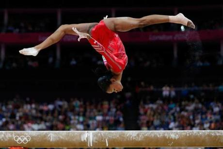 LONDON, ENGLAND - JULY 31: Gabrielle Douglas of the United States performs on the balance beam in the Artistic Gymnastics Women's Team final on Day 4 of the London 2012 Olympic Games at North Greenwich Arena on July 31, 2012 in London, England. (Photo by Jamie Squire/Getty Images)