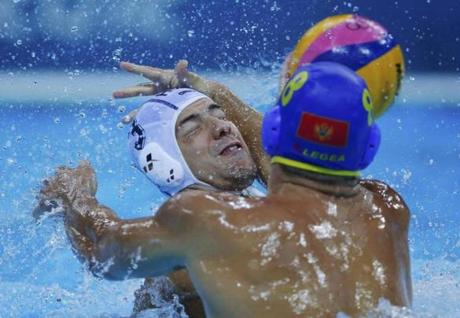 Montenegro's Nikola Janovic (R) fights for the ball with Hungary's Norbert Madaras during their men's preliminary round Group B water polo match at the Water Polo Arena during the London 2012 Olympic Games July 31, 2012. REUTERS/Laszlo Balogh (BRITAIN - Tags: OLYMPICS SPORT TPX IMAGES OF THE DAY SPORT WATER POLO)