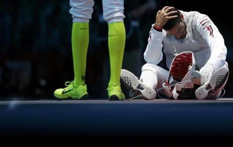 Miles Chamley-Watson of the U.S. reacts as he competes against Egypt's Alaaeldin Abouelkassem during their men's individual foil round of 32 fencing competition at the ExCel venue at the London 2012 Olympic Games July 31, 2012. REUTERS/Damir Sagolj (BRITAIN - Tags: SPORT OLYMPICS SPORT FENCING)