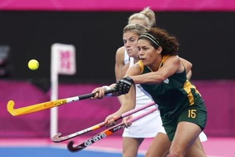 South Africa's Pietie Coetzee (R) and New Zealand's Samantha Charlton fight for the ball during their women's Group B hockey match at the London 2012 Olympic Games at the Riverbank Arena on the Olympic Park in London July 31, 2012. REUTERS/Dominic Ebenbichler (BRITAIN - Tags: SPORT OLYMPICS SPORT FIELD HOCKEY)