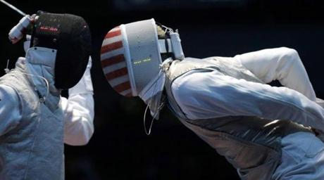 Miles Chamley-Watson (R) of the U.S. competes against Egypt's Alaaeldin Abouelkassem during their men's individual foil round of 32 fencing competition at the ExCel venue at the London 2012 Olympic Games July 31, 2012. REUTERS/Max Rossi (BRITAIN - Tags: OLYMPICS SPORT FENCING TPX IMAGES OF THE DAY)