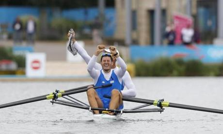 Italy's Alessio Sartori and Romano Battisti celebrate qualifying during the men's double sculls semifinal A at the London 2012 Olympic Games at Eton Dorney, west of London July 31, 2012. REUTERS/Darren Whiteside (BRITAIN - Tags: SPORT OLYMPICS ROWING)