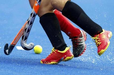 A player from China fights for the ball with a Belgium player during their women's Group A hockey match at the London 2012 Olympic Games at the Riverbank Arena on the Olympic Park July 31, 2012. REUTERS/Dominic Ebenbichler (BRITAIN - Tags: OLYMPICS SPORT FIELD HOCKEY)