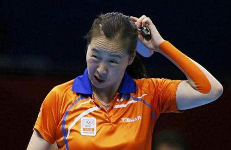 Li Jiao of the Netherlands reacts in her women's singles quarterfinals table tennis match against China's Li Xiaoxia at the ExCel venue during the London 2012 Olympic Games July 31, 2012. REUTERS/Kai Pfaffenbach (BRITAIN - Tags: OLYMPICS SPORT TABLE TENNIS)