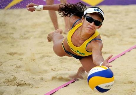 Brazil's Talita Rocha dives for the ball during their women's beach volleyball preliminary phase pool E match against Germany's Laura Ludwing and Sara Goller on The Centre Court Stadium at Horse Guards Parade in London on July 31, 2012, during the London 2012 Olympic Games. AFP PHOTO / DANIEL GARCIADANIEL GARCIA/AFP/GettyImages