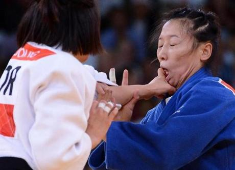 Korea's Joung Da-Woon (white) competes with China's Lili Xu (blue) during their women's -63kg judo semi-final contest match of the London 2012 Olympic Games on July 31, 2012 ExCel arena in London. AFP PHOTO / FRANCK FIFEFRANCK FIFE/AFP/GettyImages
