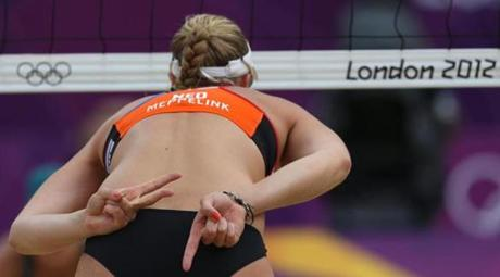 Madelein Meppelink from Netherlands signals during the Beach Volleyball match against Australia at the 2012 Summer Olympics, Tuesday, July 31, 2012, in London. (AP Photo/Petr David Josek)