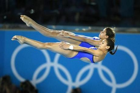 Mexico's Paola Espinosa Sanchez, front, and Alejandra Orozco Loza compete during the Women's Synchronized 10 Meter Platform Diving final at the Aquatics Centre in the Olympic Park during the 2012 Summer Olympics, London, Tuesday, July 31, 2012. (AP Photo/Jae C. Hong)