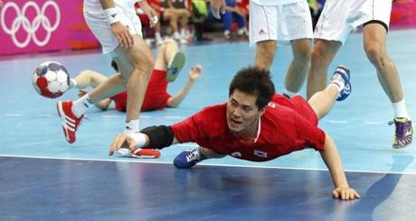 South Korea's Park Jun-geu dives to take a shot at Hungary's goal during their men's handball preliminary match at the 2012 Summer Olympics, Tuesday, July 31, 2012, in London. (AP Photo/Vadim Ghirda)