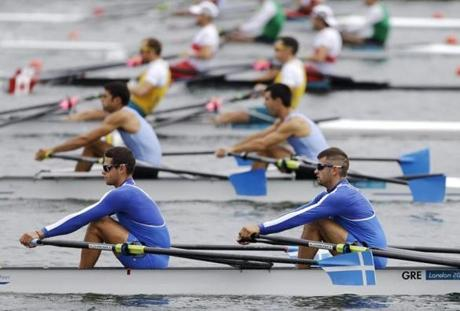 Greece's Panagiotis Magdanis, bottom left, and Eleftherios Konsolas prepare for the start of a lightweight men's rowing double sculls repechage in Eton Dorney, near Windsor, England, at the 2012 Summer Olympics, Tuesday, July 31, 2012. (AP Photo/Chris Carlson)